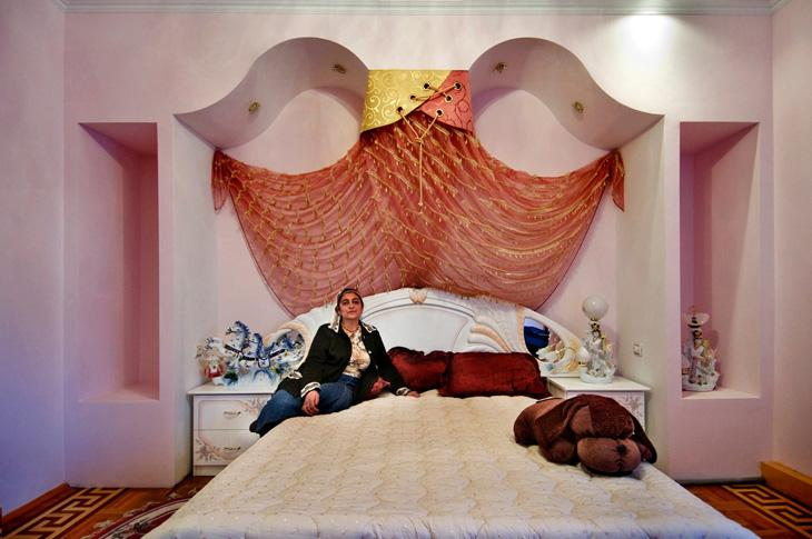 A Gypsy queen's boudoir, Soroca, Republic of Moldova. Its dramatic décor rises high above the headboards; a remarkable monument to Gypsy interior eclecticism.