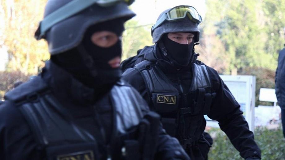 Percheziții la Ministerul Justiției și cel al Educației. 4 persoane au fost reținute de ofițerii anticorupție