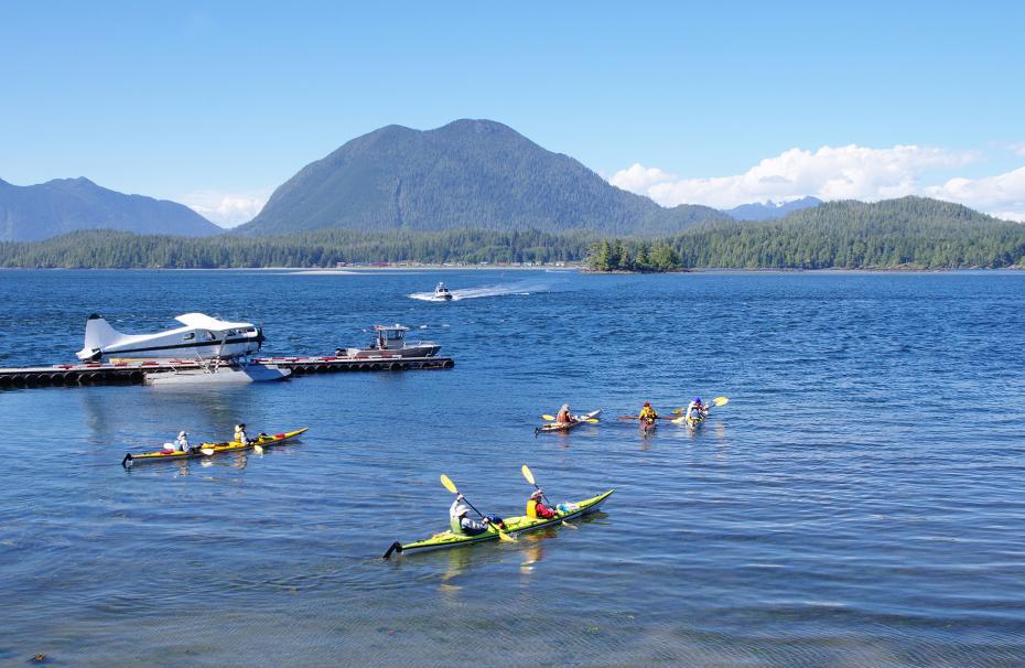 Seaplane, boats and five kayaks in Tofino port Vancouver Island, British Columbia, Canada