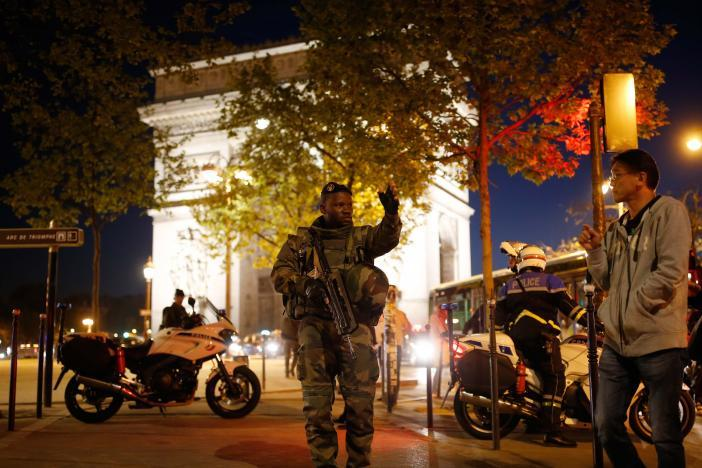 An armed soldier secures a side road near the Champs Elysees Avenue after a shooting incident in Paris, France, April 20, 2017. REUTERS/Benoit Tessier