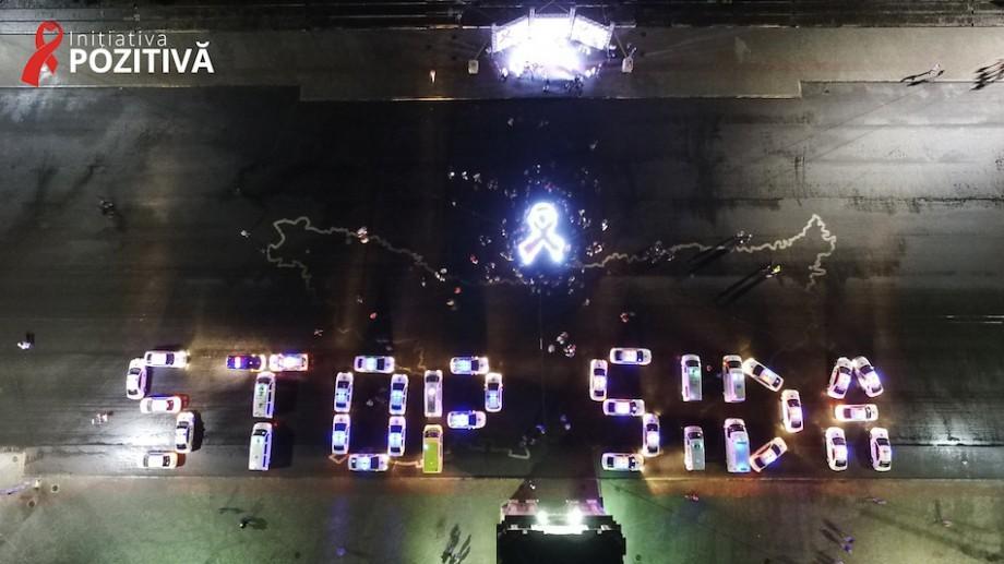 (foto) Motivul pentru care mai multe mașini cu girofaruri au scris STOP SIDA în PMAN