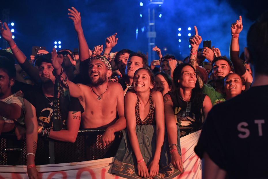 epa06061164 Fans reacts as they watch Italian singer-songwriter Vasco Rossi performing on stage at the Ferrari Park in Modena, Italy, 01 July 2017 (issued 02 July 2017). More than 200,000 people attended the event.  EPA/ALESSANDRO DI MEO