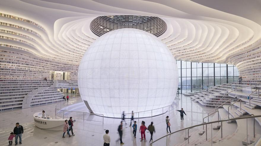 (foto, video) Înglobează 1,2 milioane de volume. Cum arată cea mai spectaculoasă bibliotecă din Tianjin