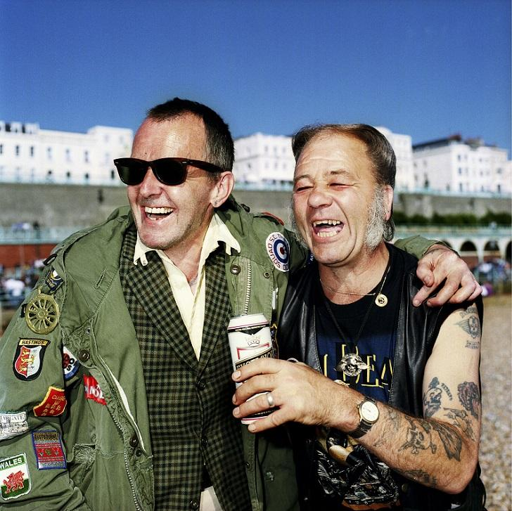 "MANDATORY CREDIT: Muir Vidler/REX Shutterstock. Only for use in this story. Editorial Use Only. Strictly no stock, books, advertising or merchandising without photographer's permission Mandatory Credit: Photo by Muir Vidler/REX Shutterstock (4896699g) ""Ray Cooke and Steve Howard were photographed on Brighton beach. Ray has been a mod since he was a teenager, now he's part of the Odd Mod Squad SC who do runs down to Brighton every summer. He bumped into Steve that day - they'd never met but they had a lot to talk about."" Rebels Without A Pause: Portrait series of Britain's ageing rebels and mavericks, Britain - 2000 FULL COPY: http://www.rexfeatures.com/nanolink/qshk A photographer has shot a fascinating portrait series of Britain's ageing rebels and mavericks. Rebels Without a Pause by Muir Vidler documents those who have refused to let their stage of life define who they are - or curtail non-conformist lifestyles. They include pensioner mods and rockers, a fire-breathing retired circus performer and a Chinese Elvis impersonator."