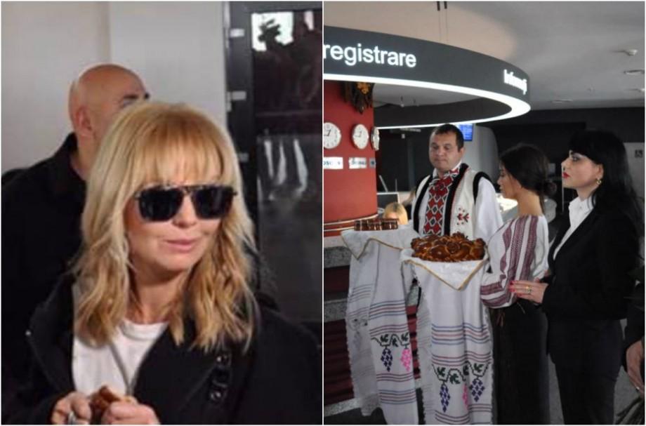 (foto) Întâmpinată cu pâine, sare și trandafiri roz. Interpreta Valeria a ajuns la Chișinău