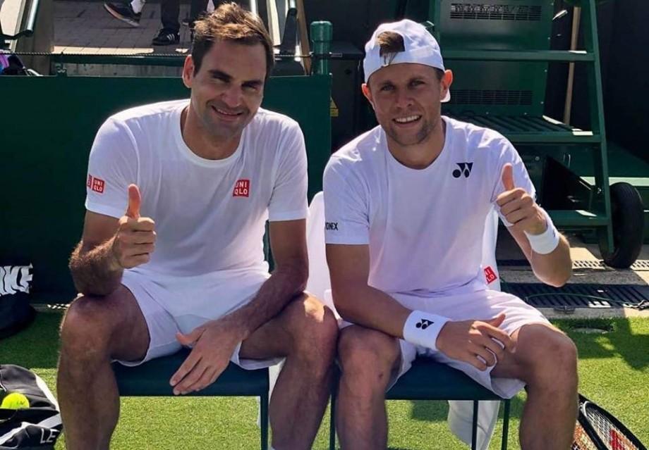 (foto) Tenismenul din Moldova, Radu Albot, s-a antrenat timp de o oră cu Roger Federer, în prima zi de Wimbledon