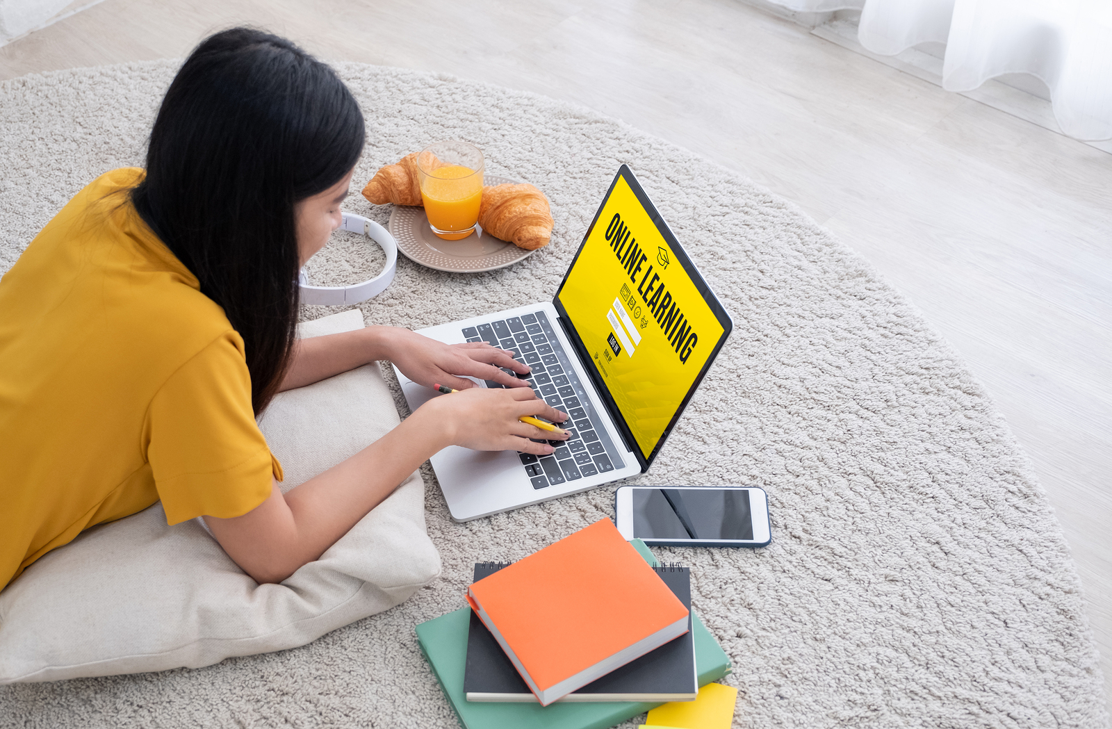 Asian Female Student Log On To E-learing Website On Laptop Comp