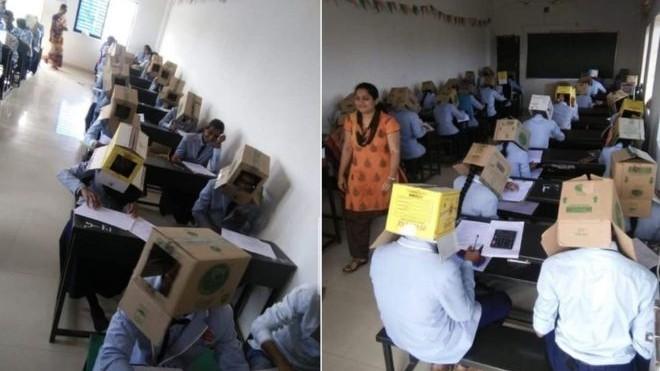 Mai mulți elevi de la un colegiu din India au fost surprinși cum purtau cutii de carton pe cap în timpul unui examen