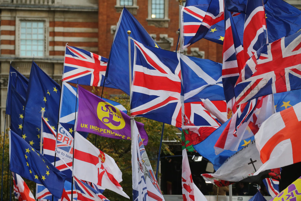 EU and Union flags fly outside the Houses of Parliament in central London on October 29, 2019. - Britain was on course for a December election today after the main opposition Labour party said it would support Prime Minister Boris Johnson's plan, although a date has not yet been fixed. (Photo by ISABEL INFANTES / AFP) (Photo by ISABEL INFANTES/AFP via Getty Images)