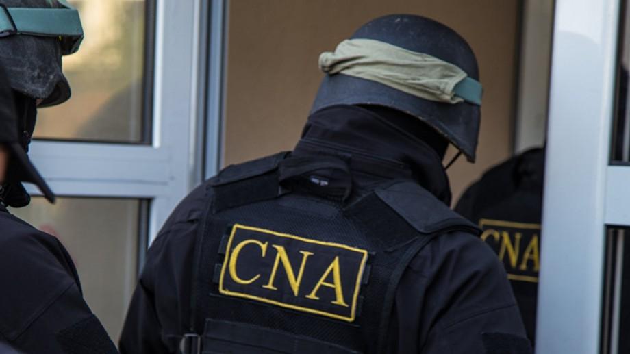 Patru persoane au fost reținut de CNA, în urma perchezițiilor de la Primăria Chișinău și de la Agenţia Servicii Publice