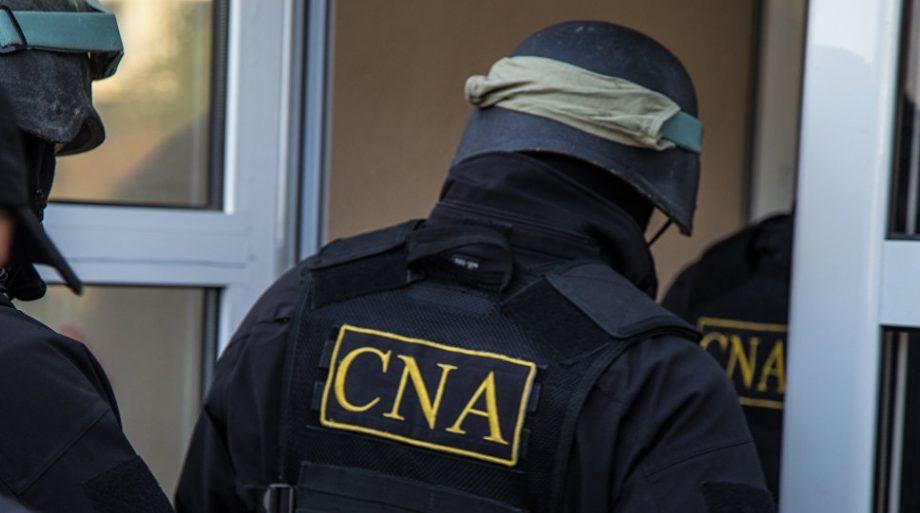 CNA desfășoară percheziții la domiciliile mai multor angajați ai Băncii Naționale a Moldovei